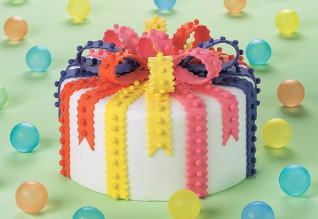 white cake with colorful fondant