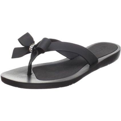 Rhinestone embellished flip flops by Guess
