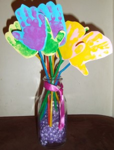 Images of Handprint Flowers on Canvas